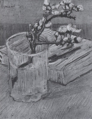 branch almond blossom in a glass with a book, arles