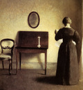 Hammershoi Vilhelm A Lady Reading In An Interior