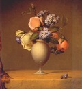 heade roses and heliotrope in vase on marble tabletop