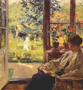 melchers woman reading by a window c1905