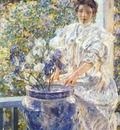 reid woman on a porch with flowers c1906