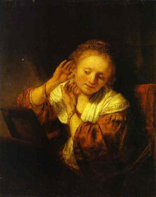 Rembrandt A Young Woman Trying on Earings