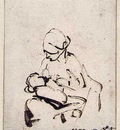 Rembrandt Woman suckling a child
