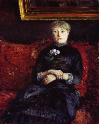 woman sitting on a red flowered sofa