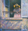 young girl in a window