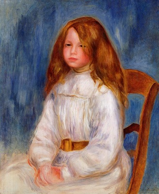 seated little girl with a blue background