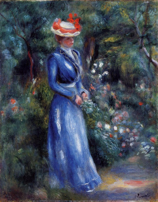woman in a blue dress standing in the garden of saint cloud