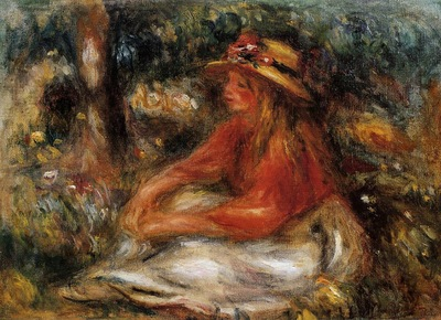 young woman seated on the grass