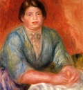 seated woman in a blue dress