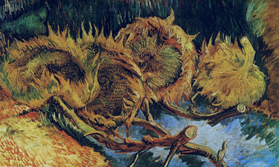 still life with four sunflowers