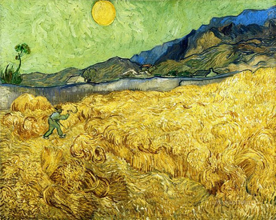 wheat fields with reaper at sunrise