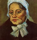 head of an old woman in a white cap