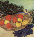 still life with oranges and lemons with blue gloves