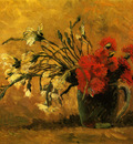 vase with red and white carnations on a yellow background